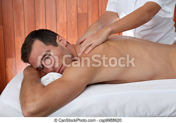 Man having a facial massage in spa center - csp9988620
