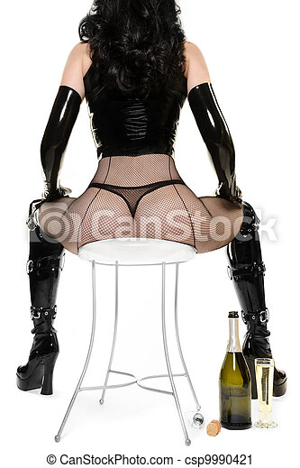 Party Time - Sexy Woman with Champagne sitting on Chair - csp9990421