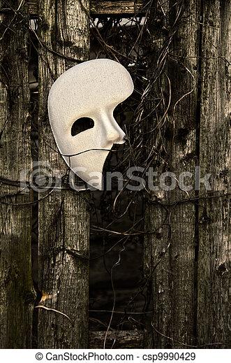 Masquerade - Phantom of the Opera Mask on Weathered Fence - csp9990429