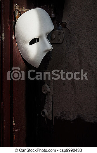 Masquerade - Phantom of the Opera Mask on Vintage Door - csp9990433