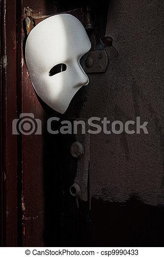 Masquerade - Phantom of the Opera Mask on Vintage Door - csp9990433