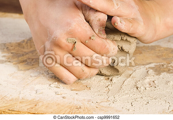 Child hands of a potter - csp9991652