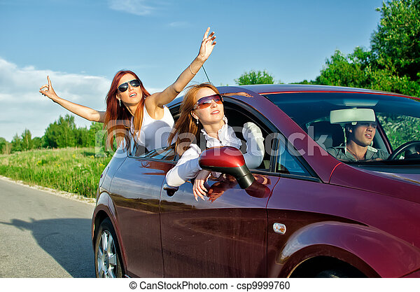 Two pretty happy girls in the car. Concept of carefree roadtrip - csp9999760