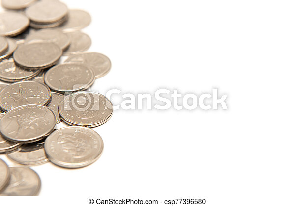 Canadian quarters isolated on white background with copy space. - csp77396580