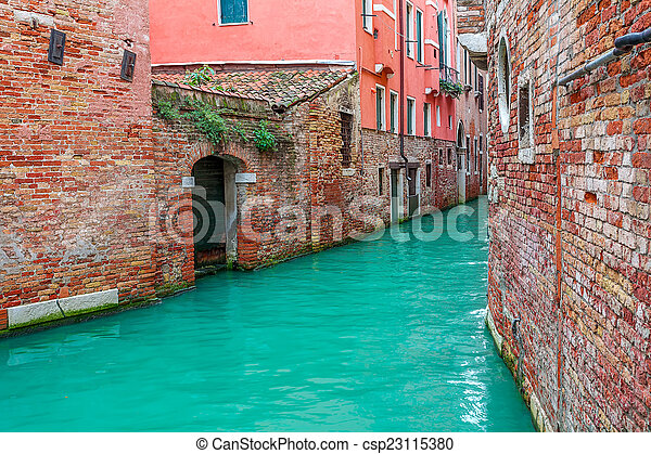 Canal and old houses in Venice, Italy. - csp23115380