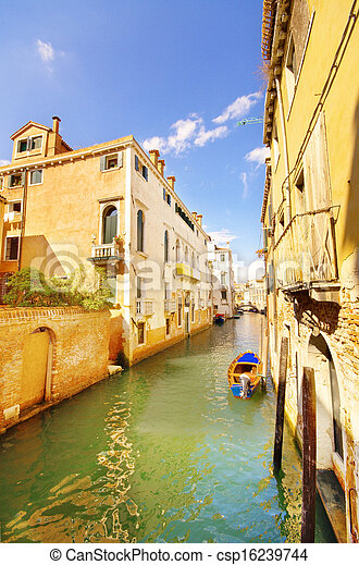 Canal and old houses in Venice, Italy - csp16239744