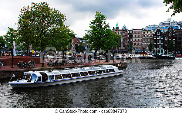 Canal in Amsterdam - csp63847373