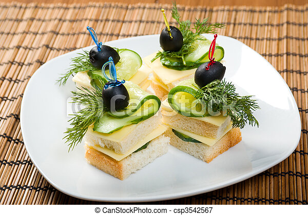 Canape with cheese and cucumber.  - csp3542567