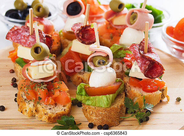 Canape with italian food ingredients - csp6365843