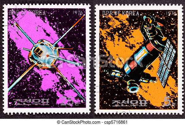 Canceled North Korean Postage Stamp Space Themed Satellites Milky Way.  Two images stitched together.  Orange stamp is space station. - csp5716861