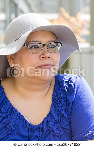 Cancer Patient Wears Hat For Sun Protection - csp26771822