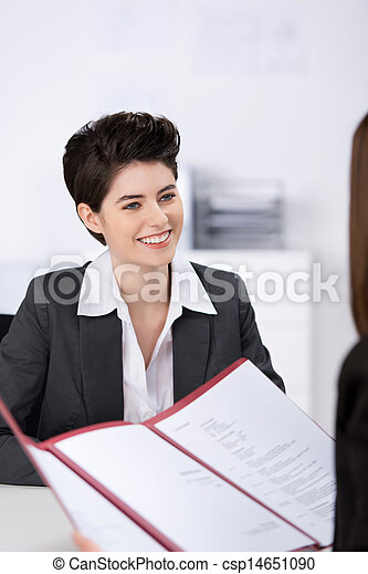 Candidate Looking At Businesswoman With Cv In Office - csp14651090