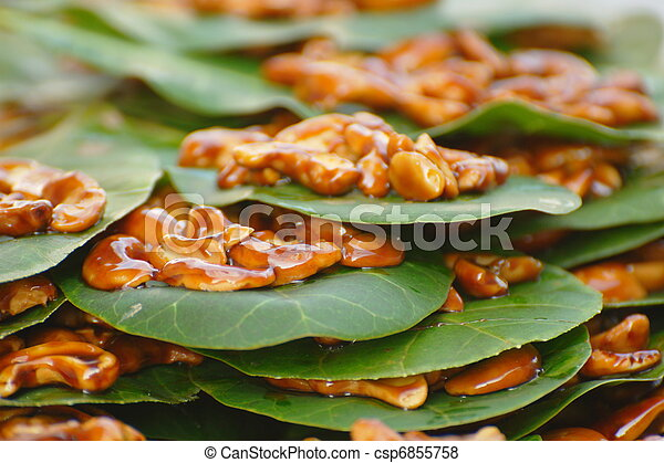 Candied Cashew Nuts on a Leaf - csp6855758