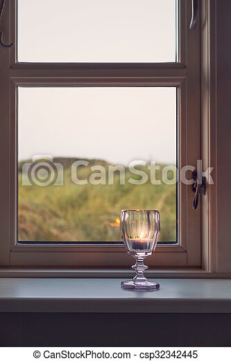 Candle in a window - csp32342445