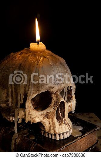 Candle on skull 5 - csp7380636