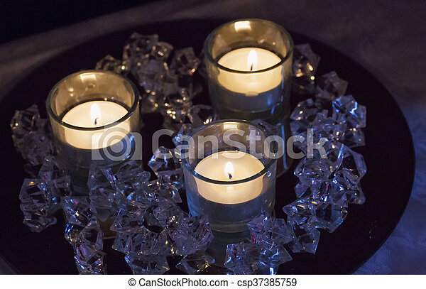 candles and stones candles over plate with crystal stones