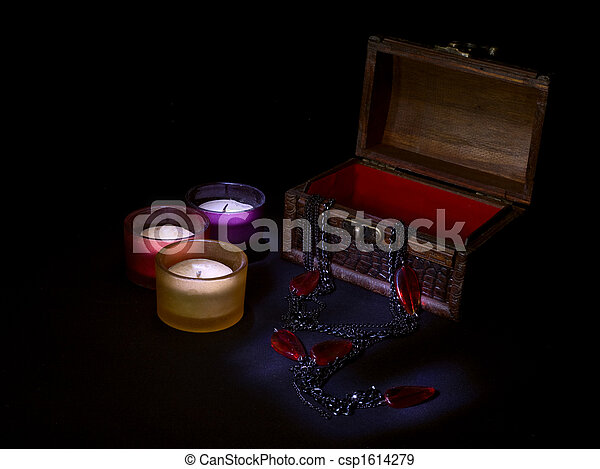 candles and wooden chest - csp1614279