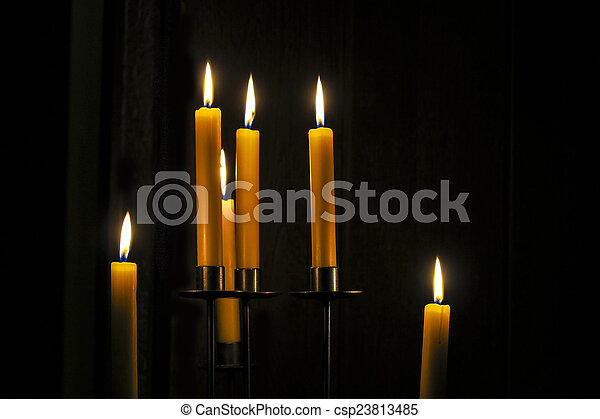 Candles burning in a  room  - csp23813485