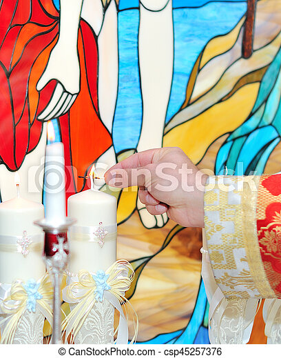 Candles during orthodox christening baptism. - csp45257376