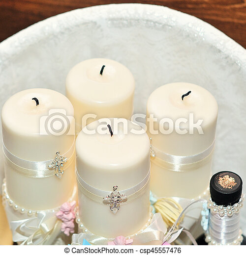 Candles during orthodox christening baptism. - csp45557476