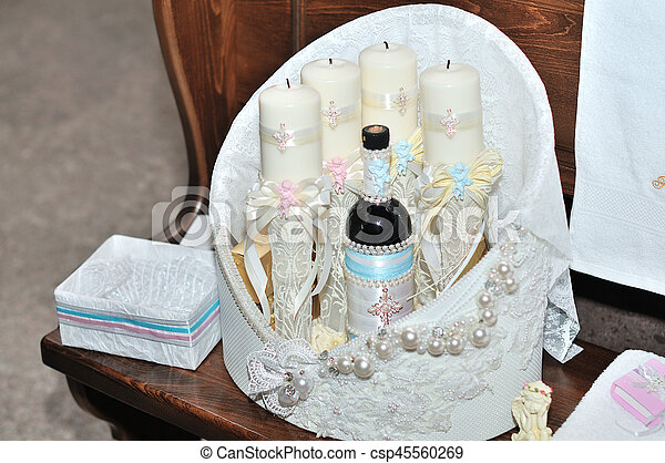 Candles during orthodox christening baptism. - csp45560269