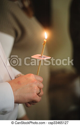 Candles during orthodox christening - csp33465127