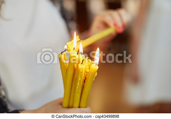 Candles during orthodox christening - csp43499898