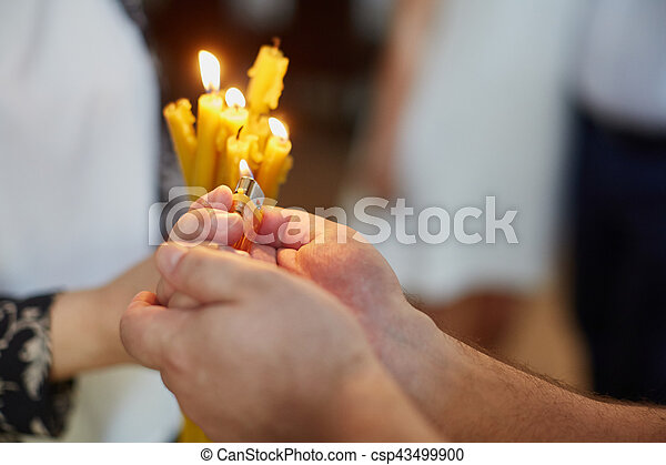 Candles during orthodox christening - csp43499900