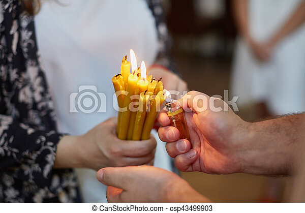 Candles during orthodox christening - csp43499903