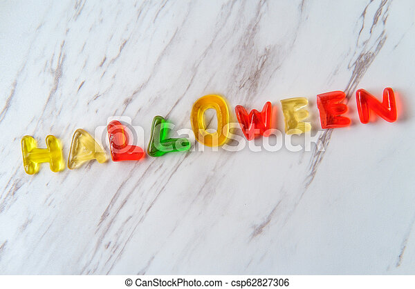 Candy Letters Spell Halloween - csp62827306