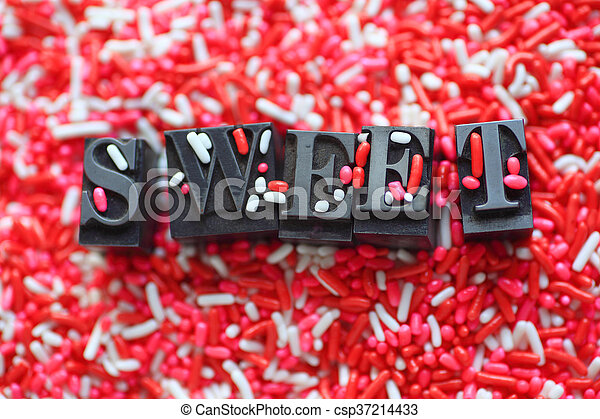 Candy sprinkles with the word sweet - csp37214433