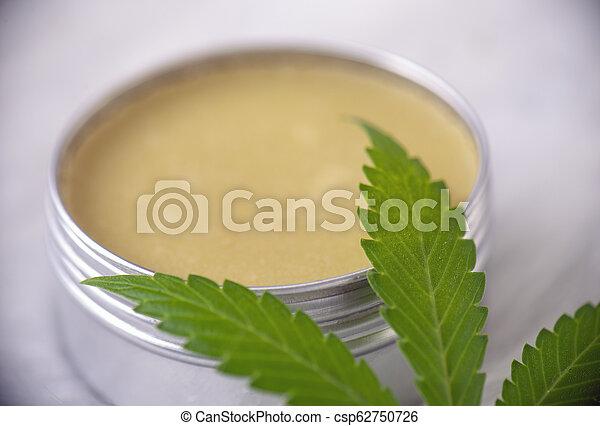 Cannabis hemp cream with marijuana leaf over white background - csp62750726
