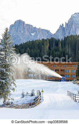 Cannon fires snow on the ski slopes - csp33838566