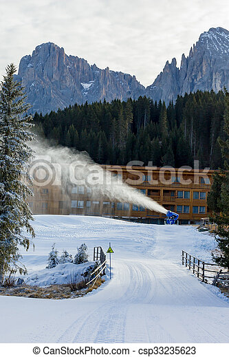 Cannon fires snow on the ski slopes - csp33235623