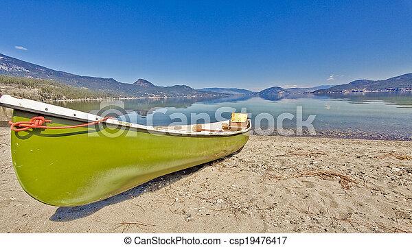 Canoe on the Lake Shore - csp19476417