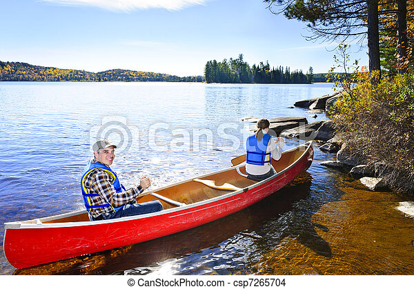 Canoeing near lake shore - csp7265704