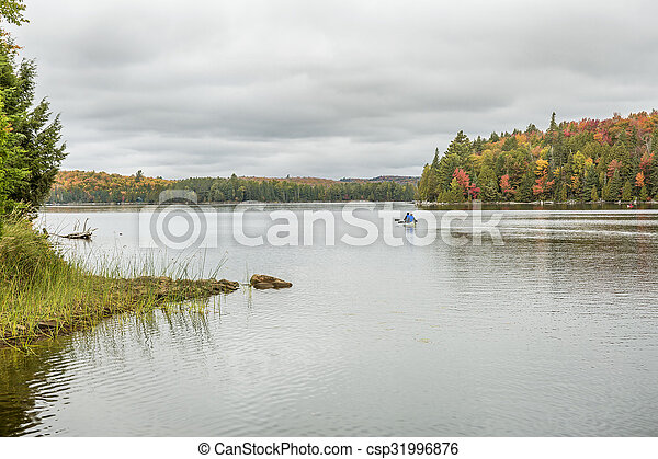 Canoeing on an Ontario Lake in Autumn - csp31996876