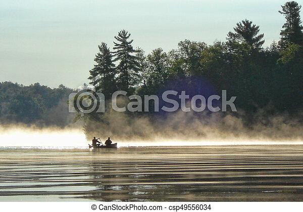 Canoeing on misty morning - csp49556034