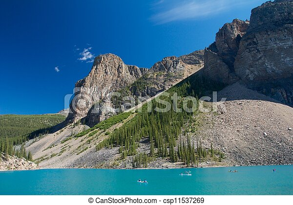 Canoes and tourists on beautiful Moraine Lake, Canada - csp11537269