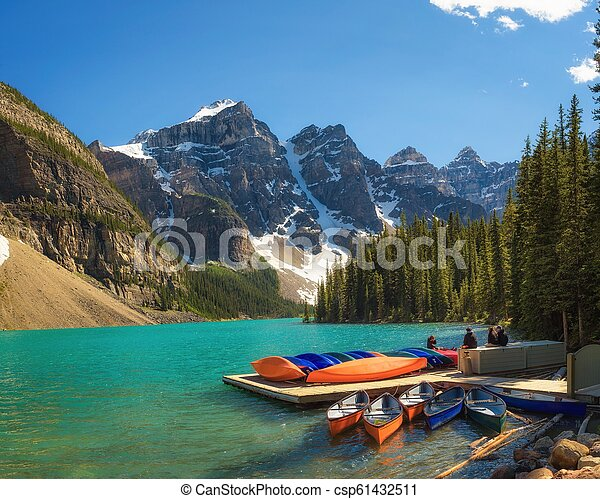 Canoes on a jetty at Moraine lake in Canada - csp61432511