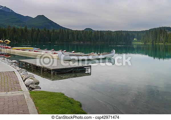 Canoes on a lake in Jasper - csp42971474