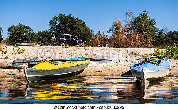 canoes on a shore - csp32630995