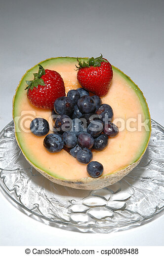 cantaloupe, blueberries and strawberries - csp0089488