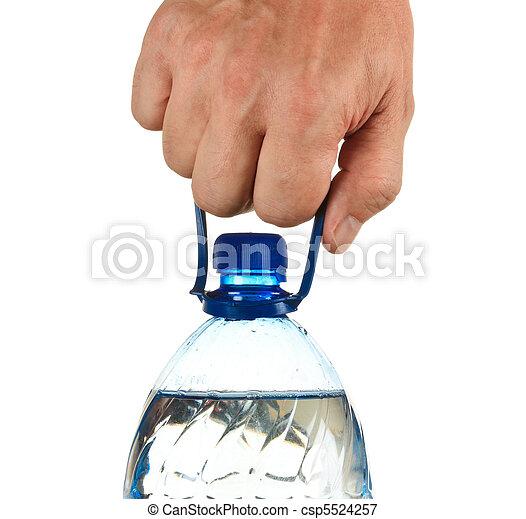 Una botella de agua en mano - csp5524257