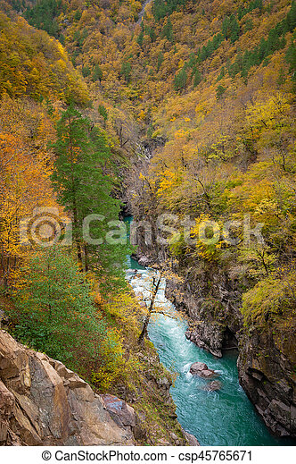 Canyon of mountain river in fall season - csp45765671