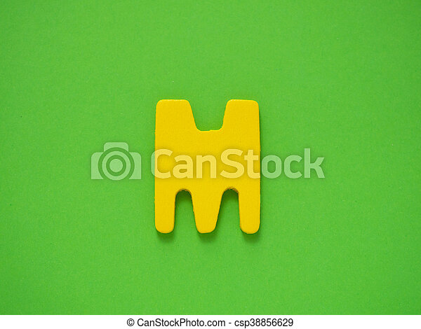 Capital Letter M Yellow From Wood On Green Background