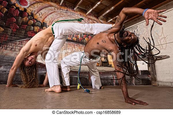 Capoeira Kicking - csp16858689