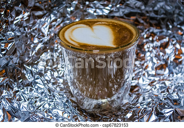 Cappuccino With Latte Art In Transparent Glass With Double Walls On The Background From A Foil Heart Strong Drink With Canstock