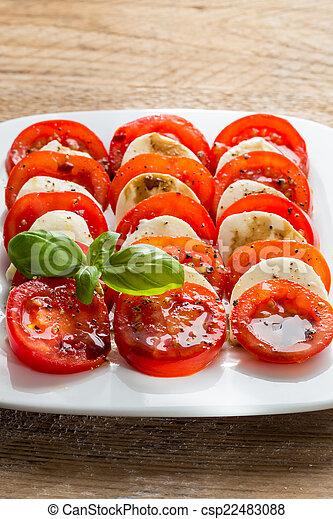 Caprese salad tomato mozzarella with basil - csp22483088