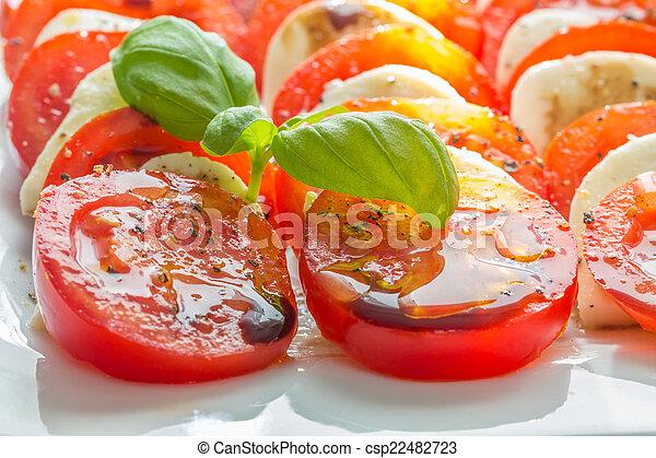 Caprese salad tomato mozzarella with basil - csp22482723